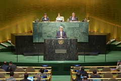 U.S. Secretary of State John Kerry speaks from the podium in the United Nations General Assembly as he addresses the 2015 Review Conference of the Parties to the Treaty on the Non-Proliferation of Nuclear Weapons at the U.N. Headquarters in New York, New York, on April 27, 2015. [State Department photo/ Public Domain]