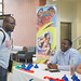 Student Tyrone Jackson listens to representatives from Hurricane Alley Waterpark at the Internship Fair.