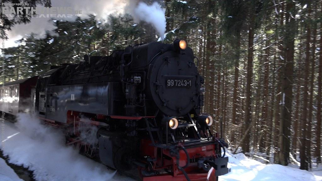 Steam Locomotive in winter forest