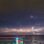 2. Mai 2016 - 20:23 - Storms over Central Florida: This is a composite of 8 frames. The first 5 frames are 25 second exposures and the last 3 are 30 second exposures, spanning from 9:03pm to 9:24pm.   This storm is far to the west of where I was shooting from, most likely it was south of Kissimmee, so 60-ish miles away.  The swirls of color are from an airboat on Lake Washington waiting for someone to show up with a trailer. When the tallest bolt of lightning hit, the boat was circling in the water in front of me with his spotlight on so I couldn't really throw out the frame. At first I was really vexed, but now I'm sort of amused by it.   I was hoping the storm would head my way, but it just sort of broke up and in the end, I didn't even see any rain here in Melbourne.