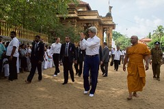 U.S. Secretary of State John Kerry bids farewell to visitors at the Kelaniya Temple in Colombo, Sri Lanka on May 2, 2015. [State Department Photo/Public Domain]