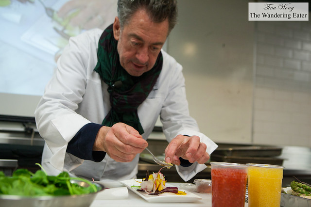 Chef Bruno Verjus of Table (Paris, France) plating his root vegetable salad with anise seed oil, trout and salmon roe