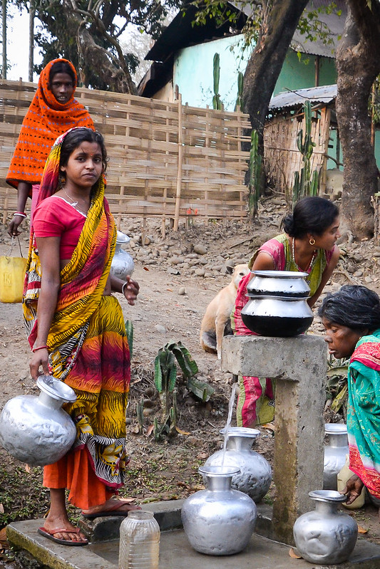 women fetching water in India