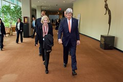 U.S. Secretary of State John Kerry walks with his sister Peggy, an employee at the United States Mission to the United Nations, through the U.N. Headquarters in New York, New York, after he addressed the 2015 Review Conference of the Parties to the Treaty on the Non-Proliferation of Nuclear Weapons on April 27, 2015. [State Department photo/ Public Domain]