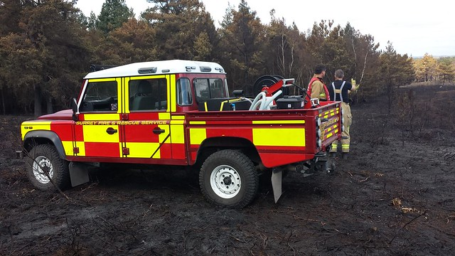 A Surrey Fire and Rescue Service Land Rover at the scene of the Pirbright fire