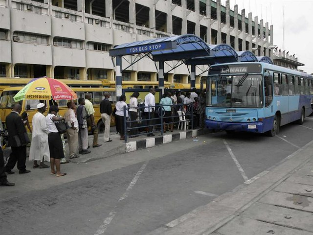 Crowds wait in line to board BRT