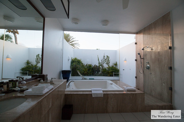 Spaceious bathroom and covered outdoor shower at Beachfront Luxury Room at Cap Juluca