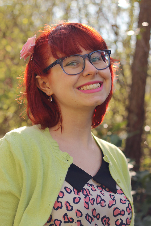 Square Shaped Blue Firmoo Glasses, Pink Flower Clip, and Bright Red Hair