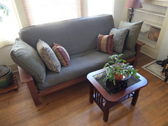 floor, furniture, wood, loveseat, room, property, laminate flooring, table, living room, interior design, couch, wood flooring, studio couch, hardwood, flooring,
