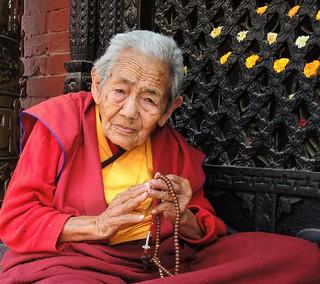 Kathmandu-Praying  Nepalese woman