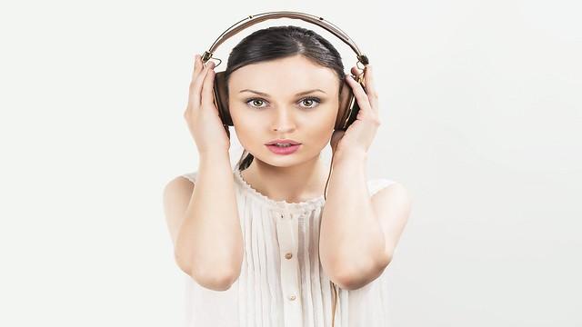 Woman with headphones listening music. Music teenager girl danci