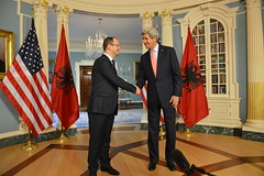U.S. Secretary of State John Kerry shakes hands with Albanian Foreign Minister Ditmir Bushati at a meeting at the U.S. Department of State in Washington, D.C. on April 20, 2015. [State Department Photo/Public Domain]