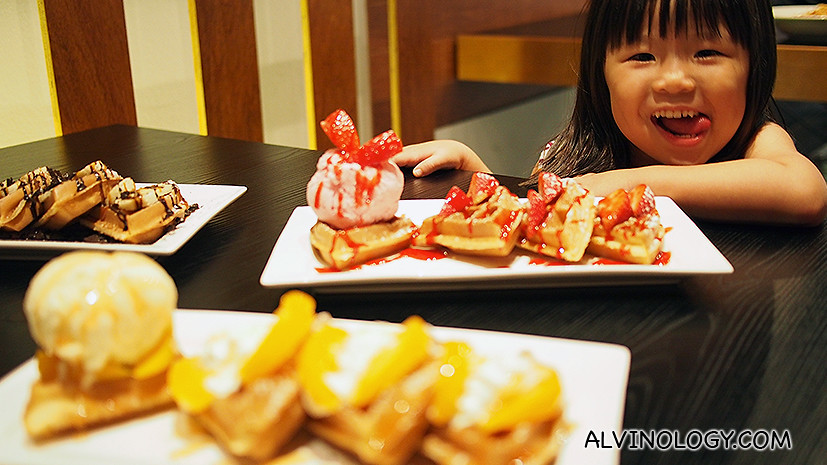 Steven Teo's little girl Stacci is happy with her dessert of three kinds of waffles.