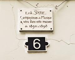 Photo of Erik Satie white plaque