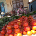 A woman sells fresh vegetables in El Fasher market, North Darfur