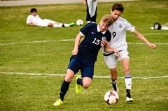 kick(0.0), women's football(0.0), football player(1.0), ball(1.0), sport venue(1.0), soccer kick(1.0), sports(1.0), competition event(1.0), team sport(1.0), tackle(1.0), player(1.0), football(1.0), ball game(1.0), ball(1.0), tournament(1.0), team(1.0),