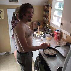 Jordan Bailey frying bacon shirtless. What style.