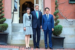 U.S. Secretary of State John Kerry poses with Japanese Prime Minister Shinzo Abe and his wife, Akie Abe, in front of his home on Beacon Hill in Boston, Massachusetts, on April 26, 2015, before a working dinner at the outset of the Abes' weeklong State visit to the United States. [State Department photo/ Public Domain]