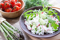 Risotto with fresh cucumber and radishes around fr…