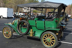 carriage(0.0), automobile(1.0), wheel(1.0), vehicle(1.0), ford model tt(1.0), touring car(1.0), antique car(1.0), vintage car(1.0), land vehicle(1.0), ford model t(1.0), motor vehicle(1.0),