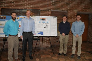 Surgical Power Tool Irrigation Pump Controller Team posing with poster