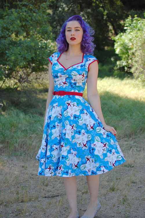 Pinup Girl Clothing Heidi dress in Mary Blair Planes print