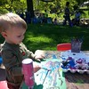 Even though he didn't feel very good, he had a good time painting at the Language Tree booth at Earth Day.