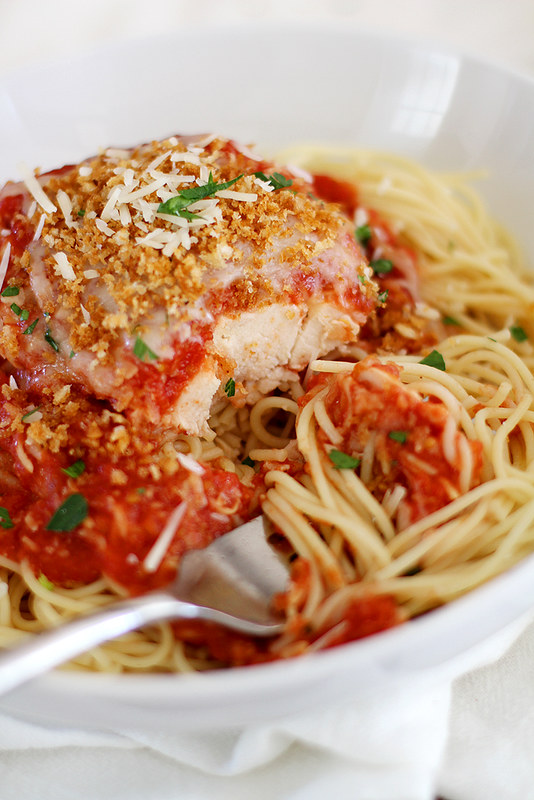 Slow Cooker Chicken Parmesan -- Tender, flavorful chicken topped with tomato sauce and melty cheese, all prepped in the slow cooker! girlversusdough.com @girlversusdough #girlversusdough #crockpot #chickendinner