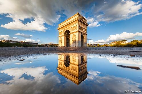 Puddle Mirror on Place de l'Etoile in Paris