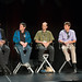 Tristan Dai (Noitom) speaking at SVVR 2015 VR Input Panel while panel watches (full body view)