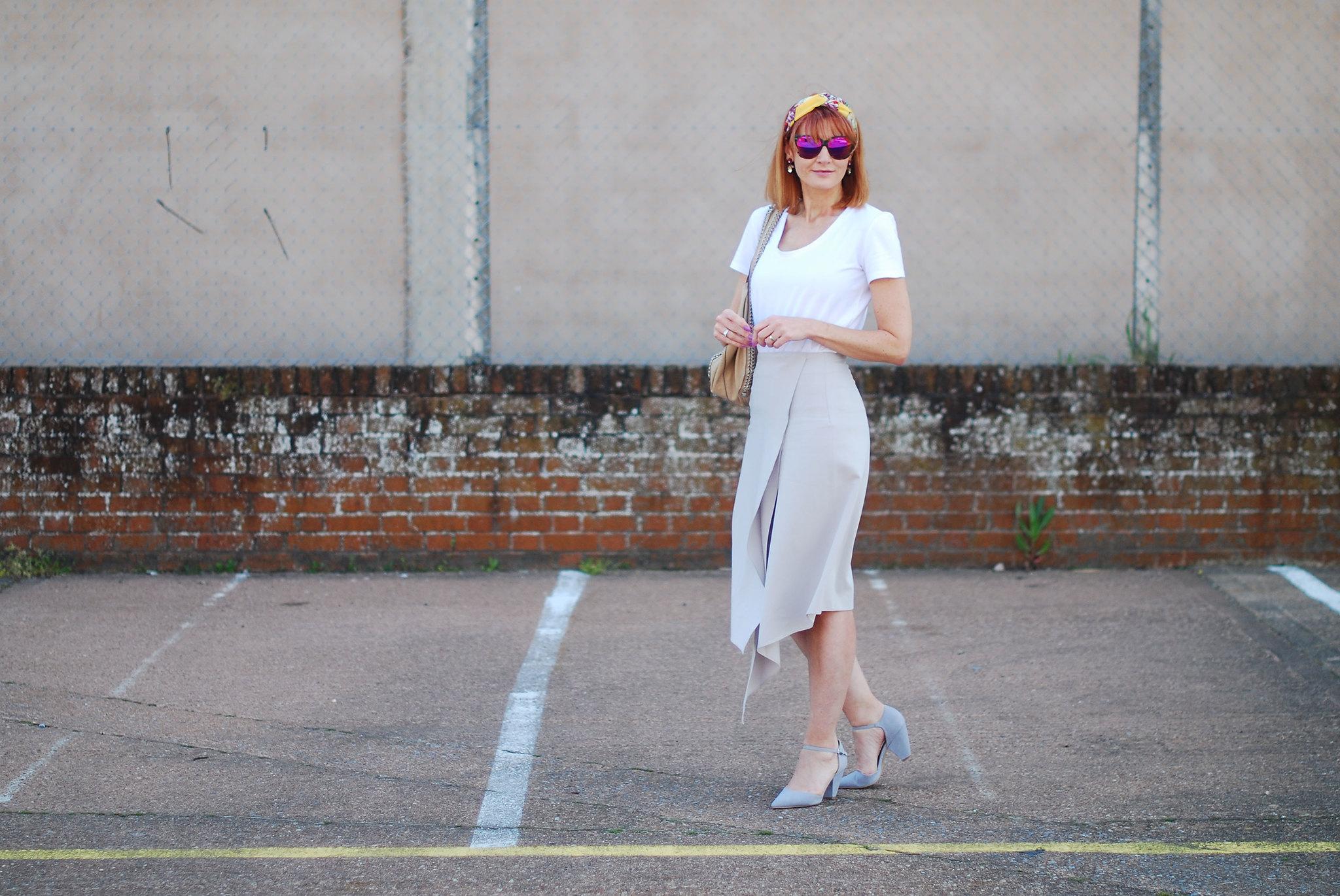 Ladylike Spring/Summer look: Plain white tee, pastel grey assymetric hem midi skirt, grey strappy heels, headscarf | Not Dressed As Lamb
