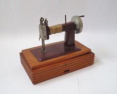 wood(0.0), sewing machine(1.0), art(1.0), iron(1.0),