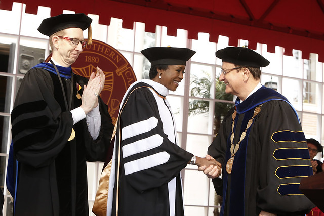 USC Provost Michael Quick and USC President C. L. Max Nikias congratulate honorary degree recipient and commencement speaker Mellody Hobson