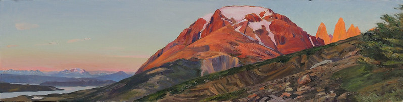 "Oil on Lined | 12 x 48 inches | Available I climbed up this mountain in the dark, hoping not to encounter the mountain lions that frequent the area. At dawn's first light I got this view of the Three Towers of Paine and the surrounding countryside, dropping off towards Lago.  On the pastel study that I did on location I wrote: ""Colors of an intensity I have never seen before..."" and I have seen a lot of intense alpenglow hitting lots of peaks before."