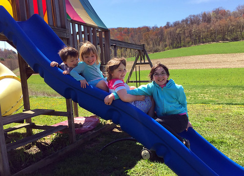 Jackson, Phoebe, Lucy, and Julia on the slide