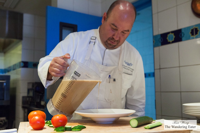 Executive Chef Jasper Schneider pouring the tomato and cucumber gazpacho