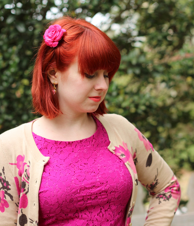 Magenta Floral Hair Clip in Red Hair and a Pink Lace Dress