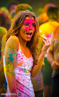 Cute pretty teen girl covered in Holi Powder
