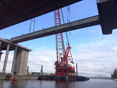 April 21, 2015 – A crane sets a girder for new floating bridge's east transition span