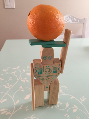 Magbot lifting an orange.