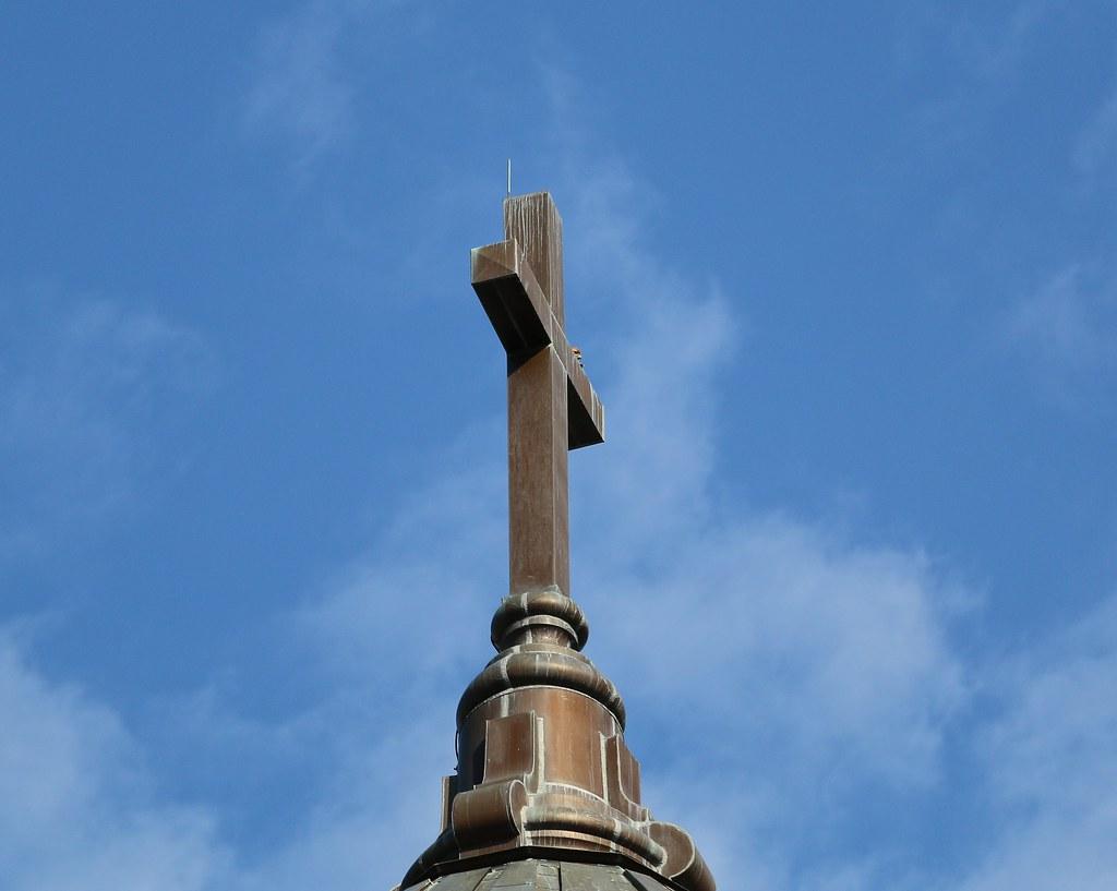 Dora peeks over the edge of the cross