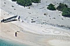 A woman looks up as a U.S. Navy P-8A Poseidon aircraft flies over East Fayu Island, Aug. 25. (U.S. Navy photo)