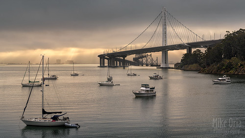 california sanfrancisco landscape outdoor photography mikeoria clippercove yerbabuena island treasureisland yacht boat sailboat sun sunrise rays beams light clouds cloudy pano panorama panoramic water bay bayarea suspension easternspan span