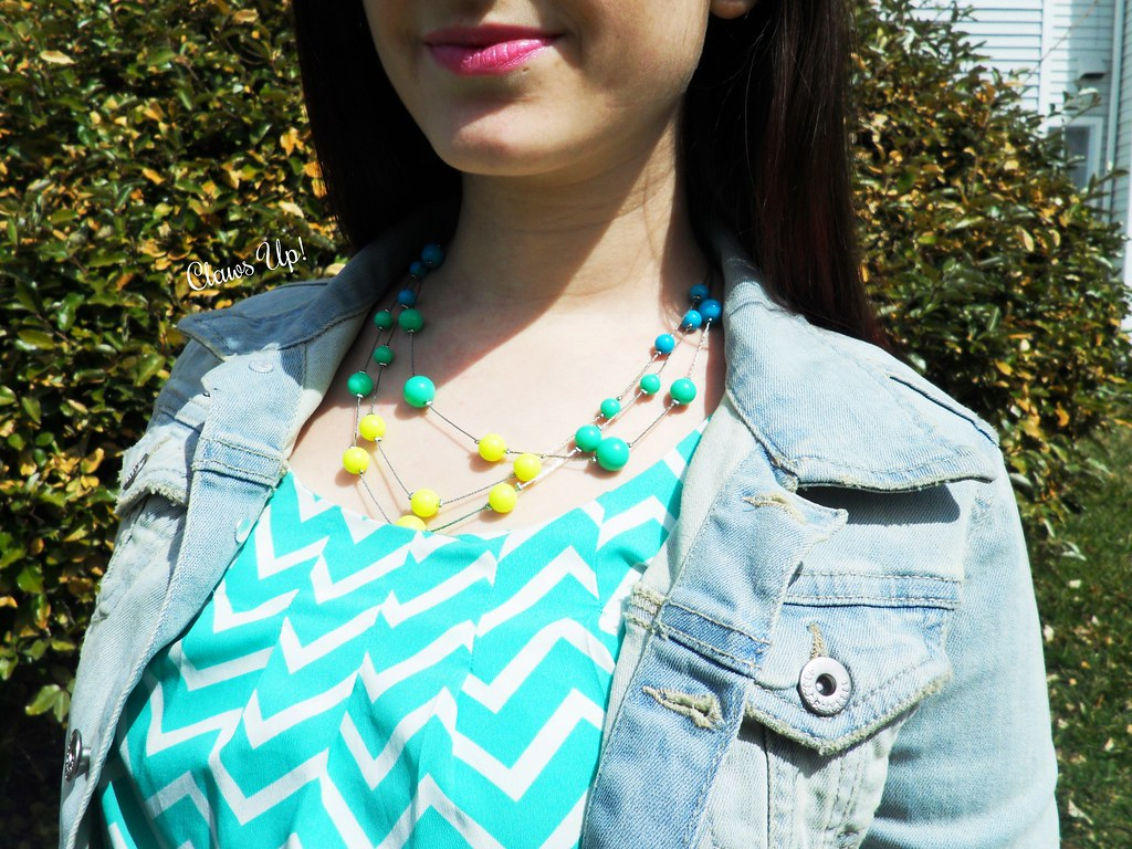 Mint chevron top, colorful necklace, and a denim jacket.