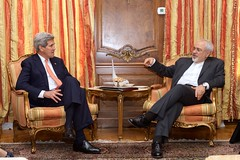 U.S. Secretary of State John Kerry sits with Iranian Foreign Minister Javad Zarif as they meeting in New York, New York, on April 27, 2015, for a talk about Iran's nuclear program on the sidelines of their attendance at the 2015 Review Conference of the Parties to the Treaty on the Non-Proliferation of Nuclear Weapons. [State Department photo/ Public Domain]