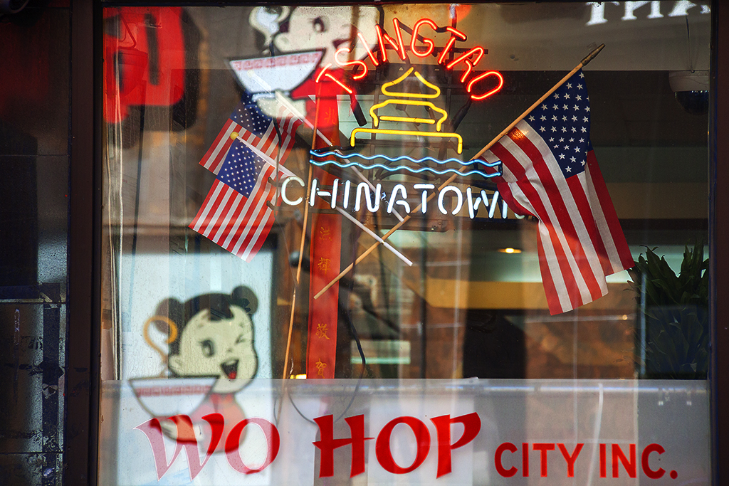 Three American flags in restaurant window--Chinatown