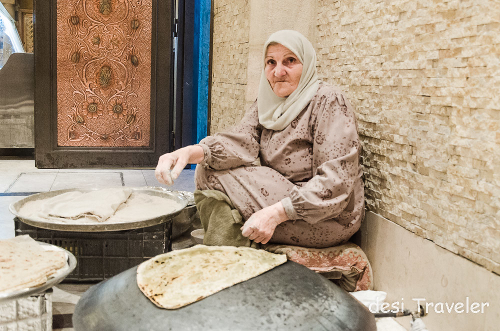 old women making traditional Shrak bread in Jordan