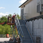 A Blue Grass Chemical Agent-Destruction Pilot Plant worker sets a staircase outside the Explosive Destruction Technology Stack Monitoring House. During operations, this facility will monitor the air released from the pollution abatement system.