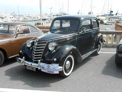 renault juvaquatre(0.0), compact car(0.0), automobile(1.0), automotive exterior(1.0), moskvitch 400-420(1.0), vehicle(1.0), mid-size car(1.0), antique car(1.0), sedan(1.0), classic car(1.0), vintage car(1.0), land vehicle(1.0), luxury vehicle(1.0), motor vehicle(1.0),