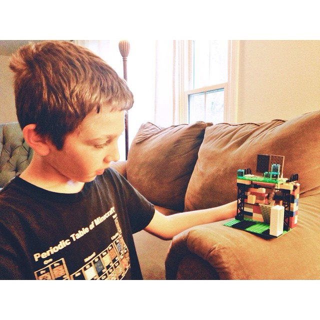 Showing off his latest Lego creation #myethan